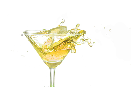 bartend: Yellow cocktail splash on white background close up.