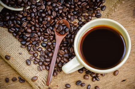 americano: Cup of Americano coffee and coffee beans