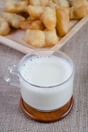 soymilk: closeup shot Soybean Milk in Glass with fried bread stick