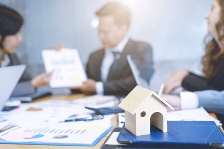 residence: Good Business teamwork analyzing income charts and graphs with Discussionwith a real estate agent at the office. house model in saving plan for residence of people. Workplace strategy Concept.