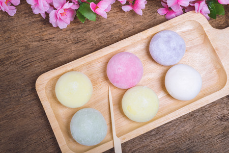The colorful mochi dessert ice cream on wood plate ,Close Up photo with selective focus. 스톡 콘텐츠
