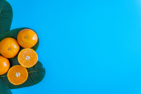 Summer fruit of orange with desktop on plates blue background. topview or flat lay fruit.