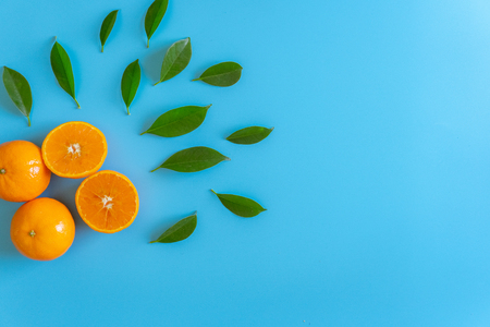 Cut fruit design of orange with desktop on plates blue background. topview or flat lay fruit.