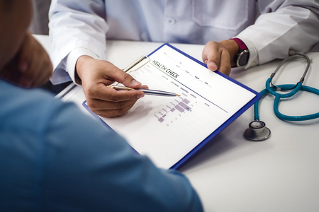 Doctor explain health check document of male patient in medical clinic or hospital health. health and doctor concept.