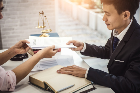 Male lawyer explain a contract agreement to client for law .Law and Legal services concept.