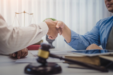 Businessman shaking hands with lawyers after discussing a contract agreement in office. justice and law ,attorney, court judge, concept.