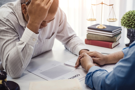Business man sit strain serious for problem of contract  insurance with lawyers consolation to solution the issue in office. justice and law ,attorney, court judge, concept. 版權商用圖片
