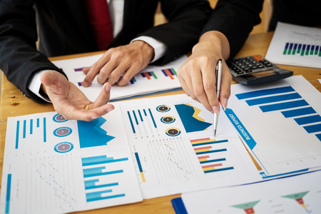 Group of business people discussing project plan together with analyzing data financial report in meeting room. Finance accounting concept.