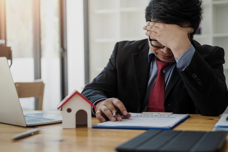 Business man eyes fatigue at work about feeling  strain tension problem. business strain concept.