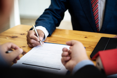 Business people discussion and negotiating investment housing estate with sign a contract term loan facility in office. contract and agreement concept.
