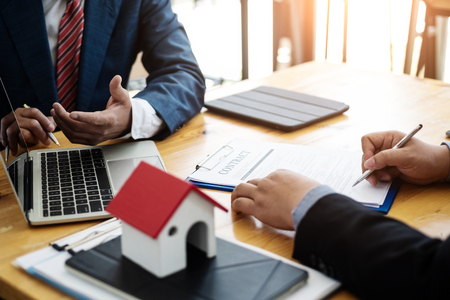 Business people discussion and negotiating investment housing estate with sign a contract term loan facility in office. contract and agreement concept. 版權商用圖片 - 120507458