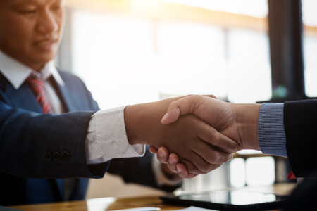 Business real estate broker and customer shaking hands after signing a contract housing estate in office. contract and agreement concept. 스톡 콘텐츠