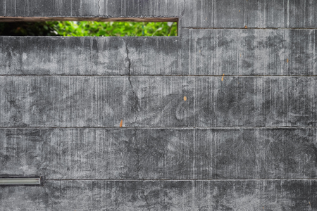 long shot: the grunge concrete wall in the city with a void. Long shot. Archivio Fotografico