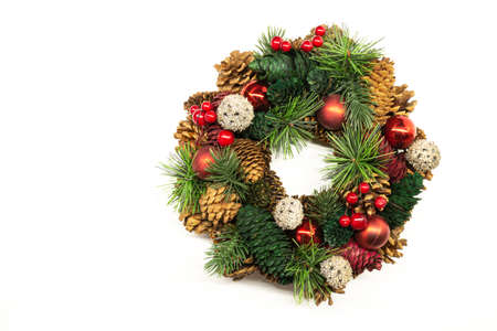 Christmas wreath of fir branches and cones on a white background 版權商用圖片