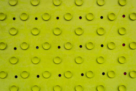 Rubber light green old cracked bath mat with holes and suction cups.