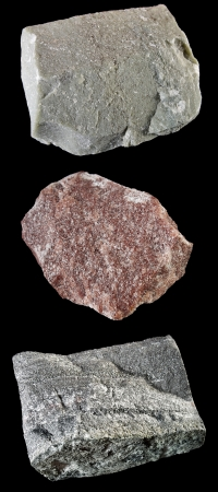 closeups: Close-ups of rocks and minerals on black  From top to bottom  Ophicalcite  Verd antique , Crimson quartzite  Royal stone , Ferruginous quartzite  Jaspilite