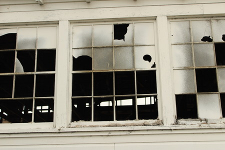 Broken Windows in Historic Warehouse Imagens