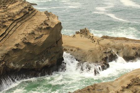 drips: Coastal Water drips off Rocks Stock Photo