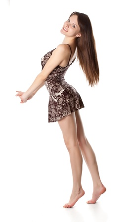 barefoot teens: Beautiful girl is posing  Isolated on a white backround Stock Photo