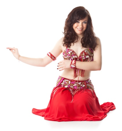 bellydancing: beautiful woman in dancing arabic dance  isolated on white