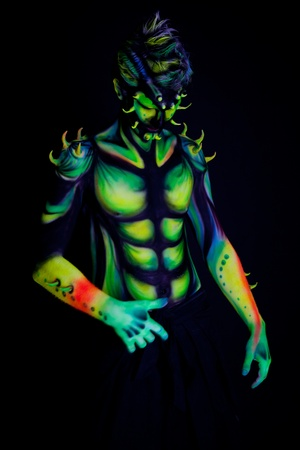 Man with fluorescent bodyart  Black background  Studio shot Foto de archivo