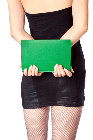 Woman in miniskirt is holding the green book  Isolated on white background photo