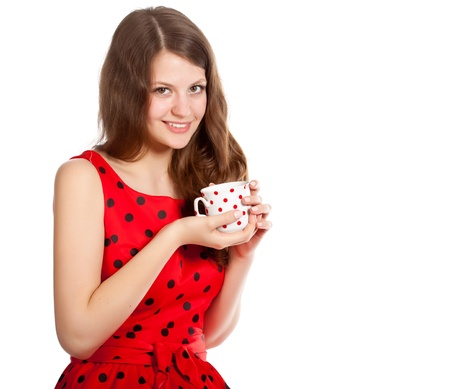 Young girl with a cup of tea in her hands  Isolated on white background  Studio shot