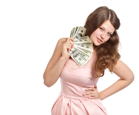 Joyful teenage girl with dollars in her hands  Studio shot  Isolated on white background