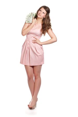 Joyful teenage girl with dollars in her hands is looking up  Studio shot  Isolated on white background photo