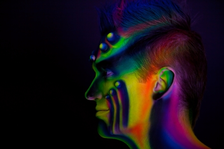 Man with fluorescent bodyart  Black background  Studio shot Stock Photo