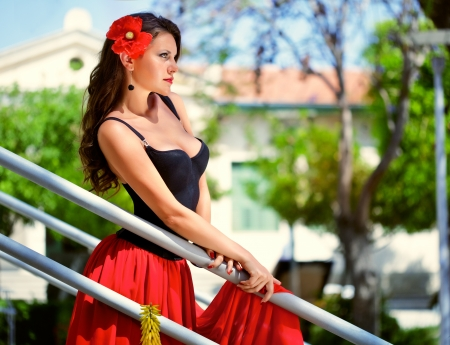A beautiful spanish woman on the stairs Stock Photo - 14002175