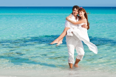A loving couple is on the beach Stock Photo