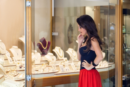 jewelry store: A beautiful woman is in the jewelry store