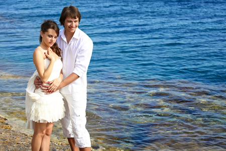 A beautiful couple on the beach photo