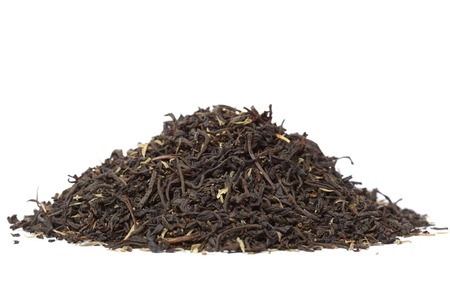 Heap of dry tea. Isolated on white background