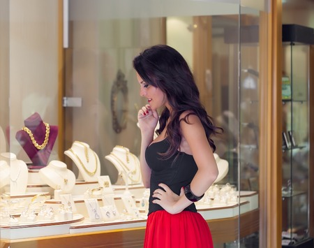 A beautiful woman is in the jewelry store photo