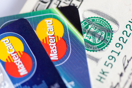 mastercard: RUSSIA, OREL - 01 DECEMBER 2014: Two credit cards by Mastercard and dollar bills