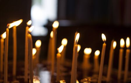 easter candle is burning: Candles in the church on the background bokeh Stock Photo