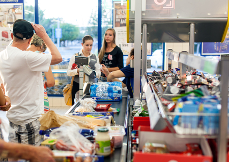 CYPRUS, PROTARAS, SUPERMARKET LIDL - 19.09.2015:Customers paying for shopping at a supermarket. Line at the cashdesks in the supermarket