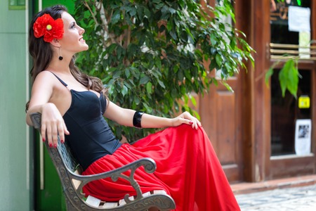 spanish woman: A spanish woman relaxing on the bench near her home