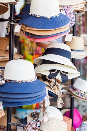 shelfs: Hats on the shelfs in clothing store