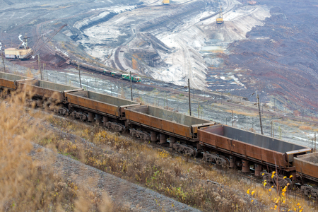 Train at the iron ore opencast mine is going for loading iron