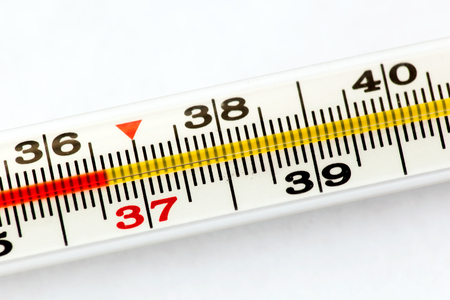 Traditional medicine thermometer with normal temperature 36.6 degrees.