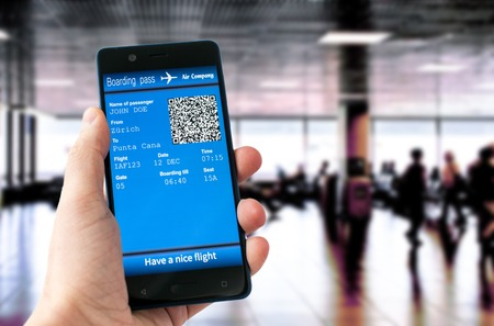 hand holding mobile phone with mobile boarding pass Stock Photo