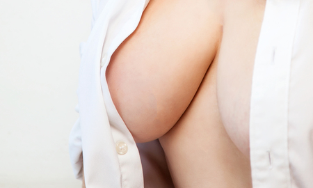 Woman with large breastswithout bra and white shirt Stock Photo