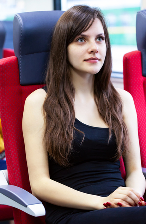 Young beautiful woman traveling by train. Stock Photo - 108409008