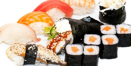 Top view on sushi set isolated over white background. Plate with rolls close-up. Stock Photo