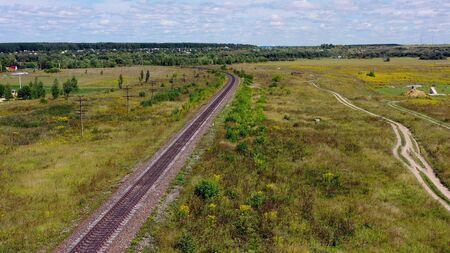 Empty straight single-way railways at summer sunny day.