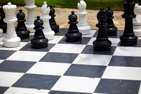 Big chess on the board located on the ground