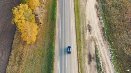 Aerial view of cars driving on country autumn road Stok Fotoğraf